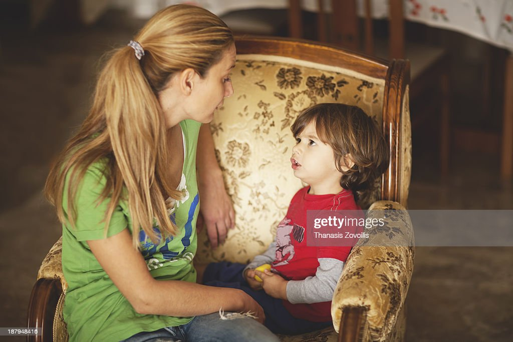 Mother talking to her son : Stock Photo