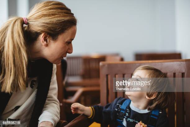 Mother talking to her son