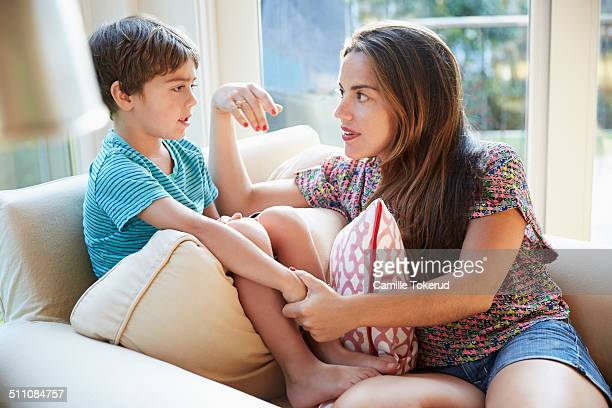 mother talking to son on the sofa - family with one child stock pictures, royalty-free photos & images