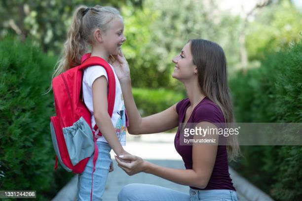 mother talking with daughter before school - day 1 stock pictures, royalty-free photos & images