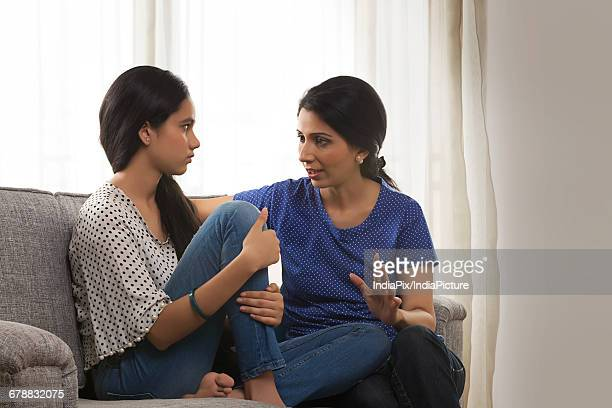 Mother talking with her teenage daughter