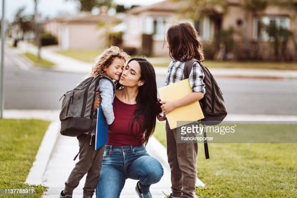 mother talking with sons after school - first day of school stock pictures, royalty-free photos & images