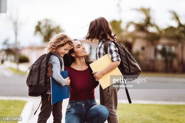 mother talking with sons after school - back to school stock pictures, royalty-free photos & images
