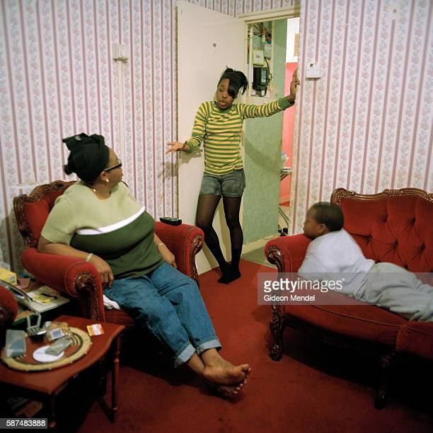 A mother talks to her angry teenage daughter while her brother looks on in their flat on the Kingsmead Estate in Homerton in the eastern part of...