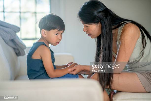 mother teaches her son a difficult lesson - penalty stock pictures, royalty-free photos & images