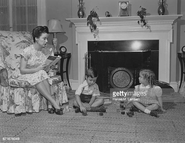 Mother Teaching Her Children