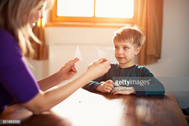 Mother teching son at home about shapes