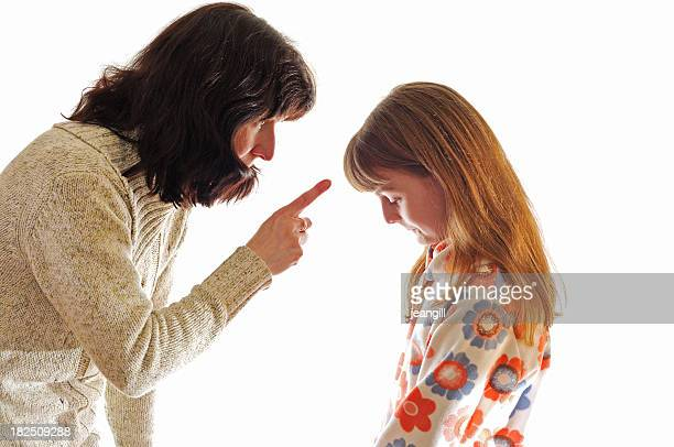 mother telling off daughter