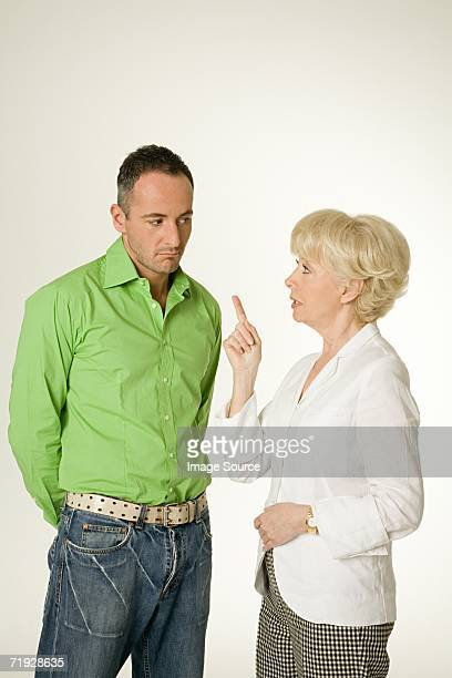 mother telling off son - scolding stock photos and pictures