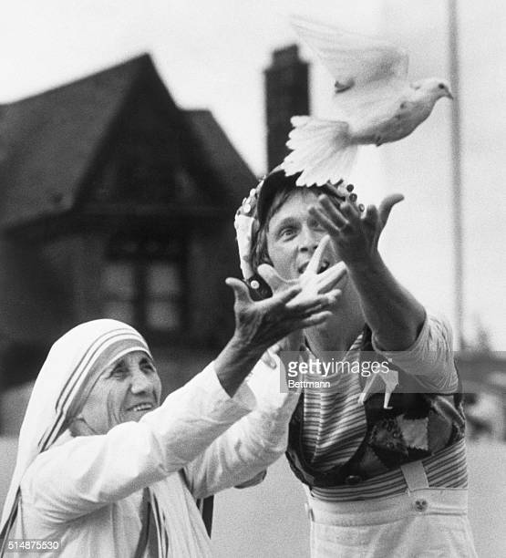 Mother Teresa and Robert Morgan on behalf of Youth Corps release a dove as a symbol for peace in front of 20000 people at Varsity Stadium