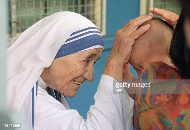Mother Teresa gives her blessing to a child at the Gift of Love Home on October 20 in Singapore The 1979 Nobel Peace Prize winner is on a stopover...