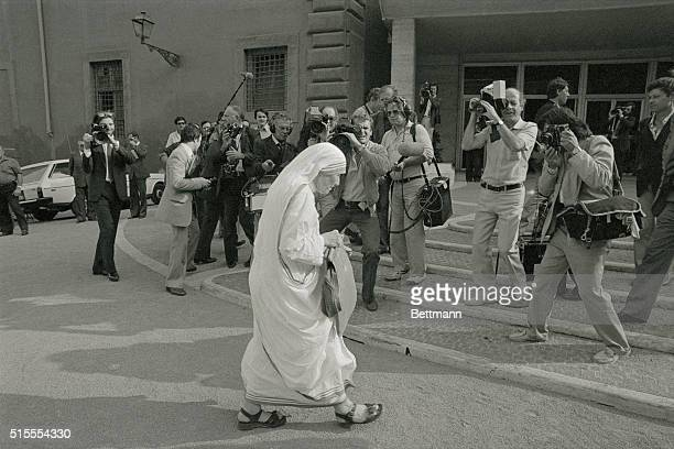 Mother Teresa of Calcutta pass a battery of photographers here, as she arrives in the Vatican to attend the 5th World Synod of Bishops.