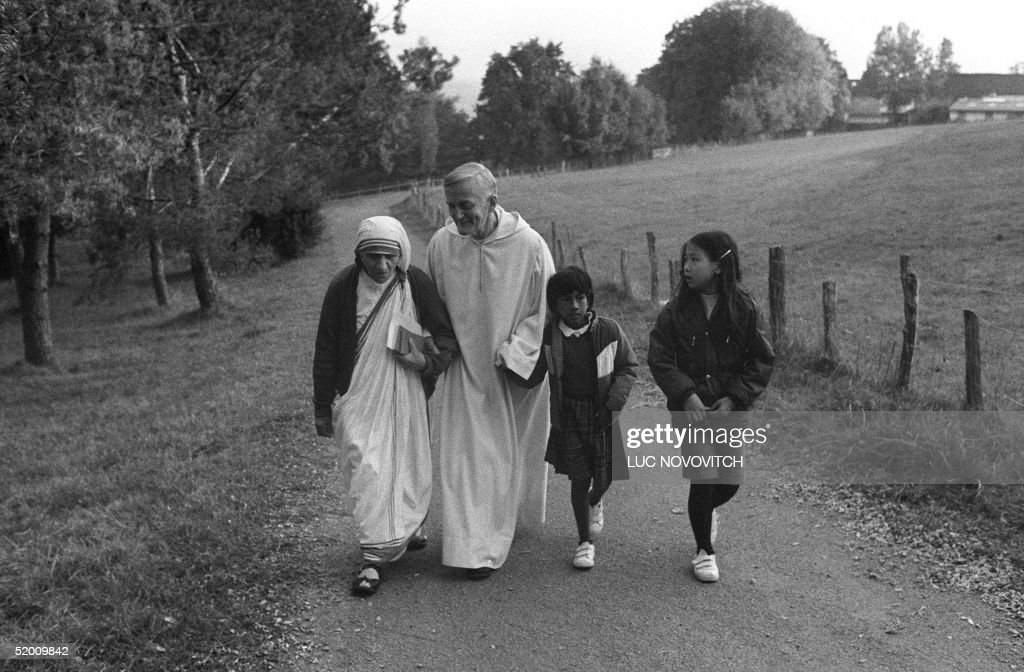 Mother Teresa of Calcutta (L), the humble nun known as the 'saint of the gutters', walks together with the brother Roger Schutz-Marsauche, founder and preacher of the community of Taize, during her pilgrimage to Taize 23 October 1983. Mother Teresa was beatified 19 October 2003 by Pope John-Paul II.