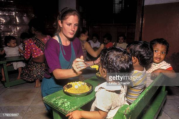 CONTENT] Mother Teresa volunteer Kari Amber McAdam a Dartmouth College student had no problem caring for several hungry children at once Kari was...