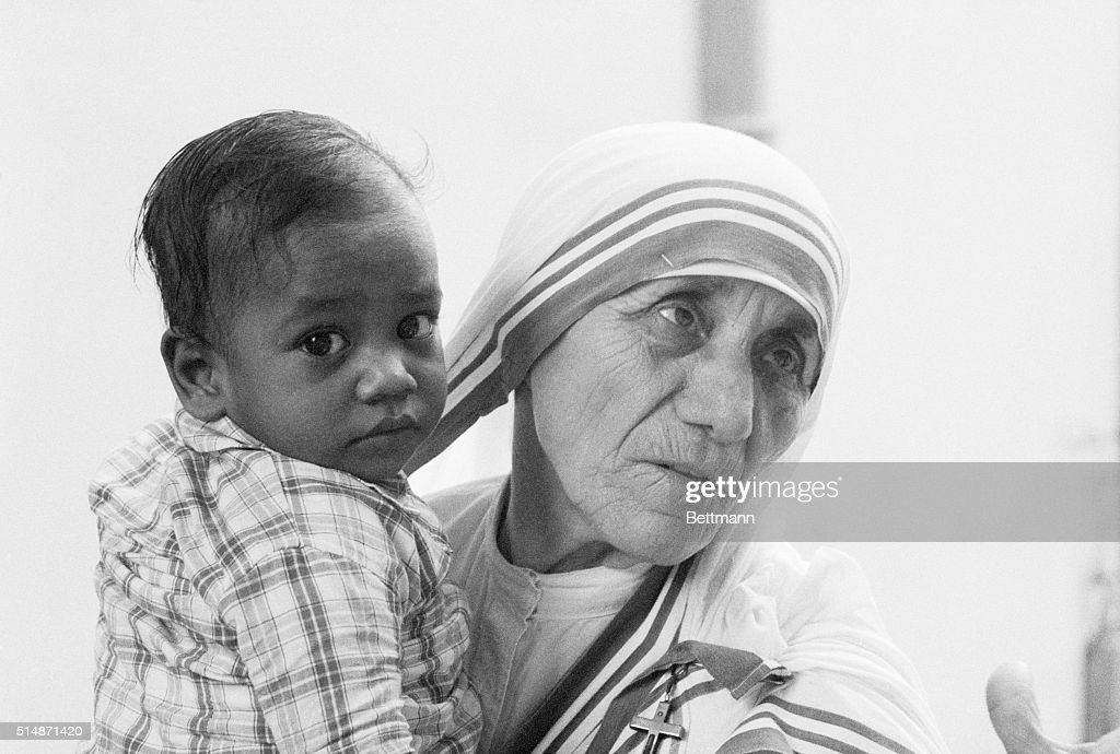 Mother Teresa, who was recently announced as the winner of the 1979 Nobel Peace Prize, holds a young boy from a Calcutta orphanage. The Roman Catholic nun said she would retreat from the world for a month of silence before traveling to Oslo to receive the prize.