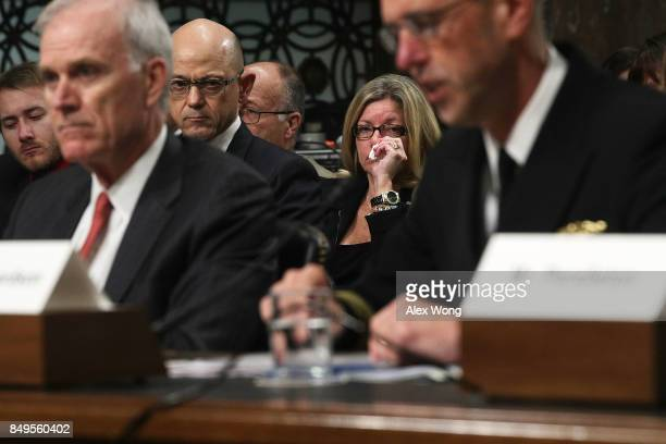 Mother Theresa Palmer of Interior Communications Electrician 3rd Class Logan Palmer who was killed on USS John S McCain listens as US Secretary of...