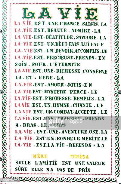 Mother Theresa's hymn on French garden wall plaque