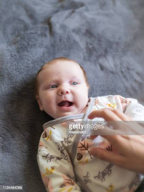 mother tickling her laughing baby girl - tickling stock pictures, royalty-free photos & images