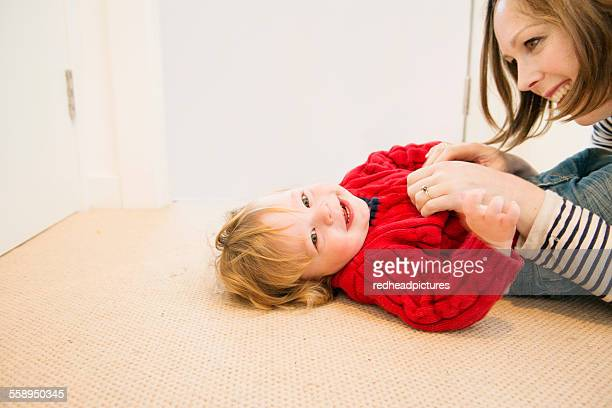 Mother tickling son