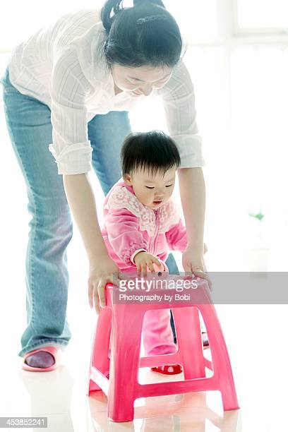 Mother to protect her daughter learn to walk