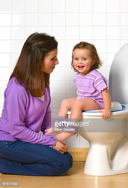 Mother toilet training daughter