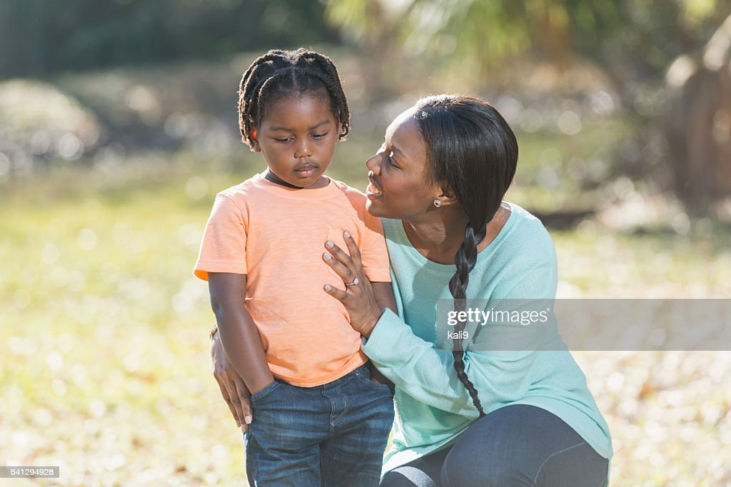 Mother trying to cheer up sad her little boy : Stock Photo