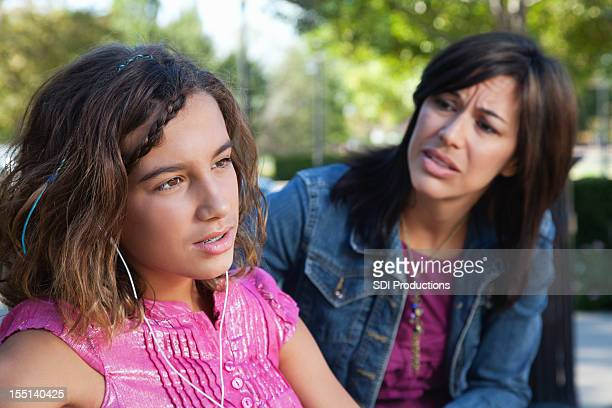 Mother trying to talk with turned-off teenager