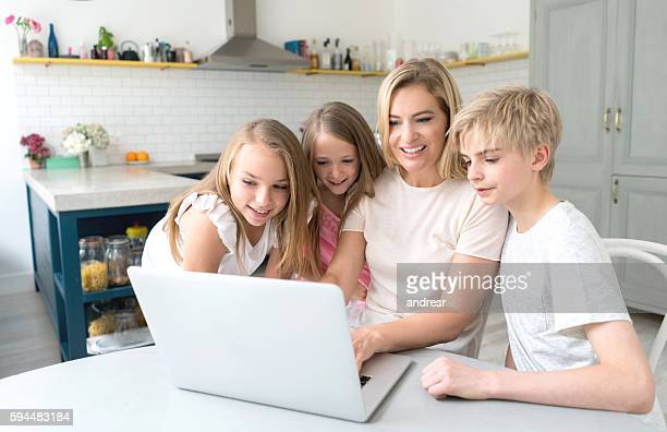 Mother using a laptop computer with her kids
