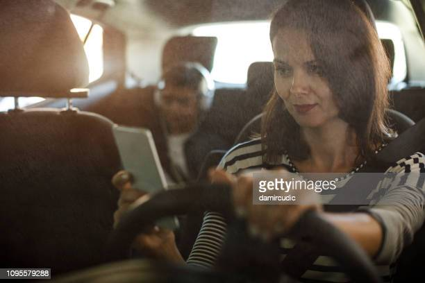 Mother using mobile phone while driving a car