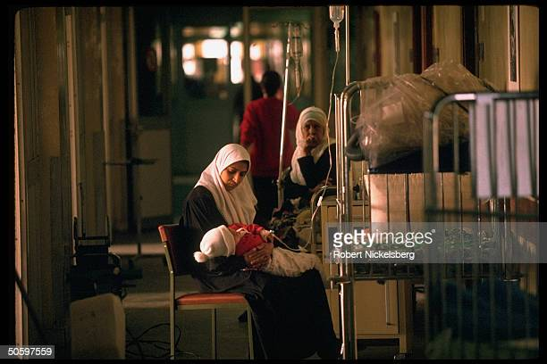 Mother w ill child at Saddam Children's Hospital re malnutrition consequent diseases in young due to lack of milk medicines re Gulf War sanctions