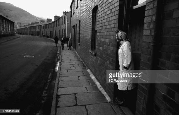 A mother waits for her son to return from school in November 1966 in the mining town of Aberfan South Wales