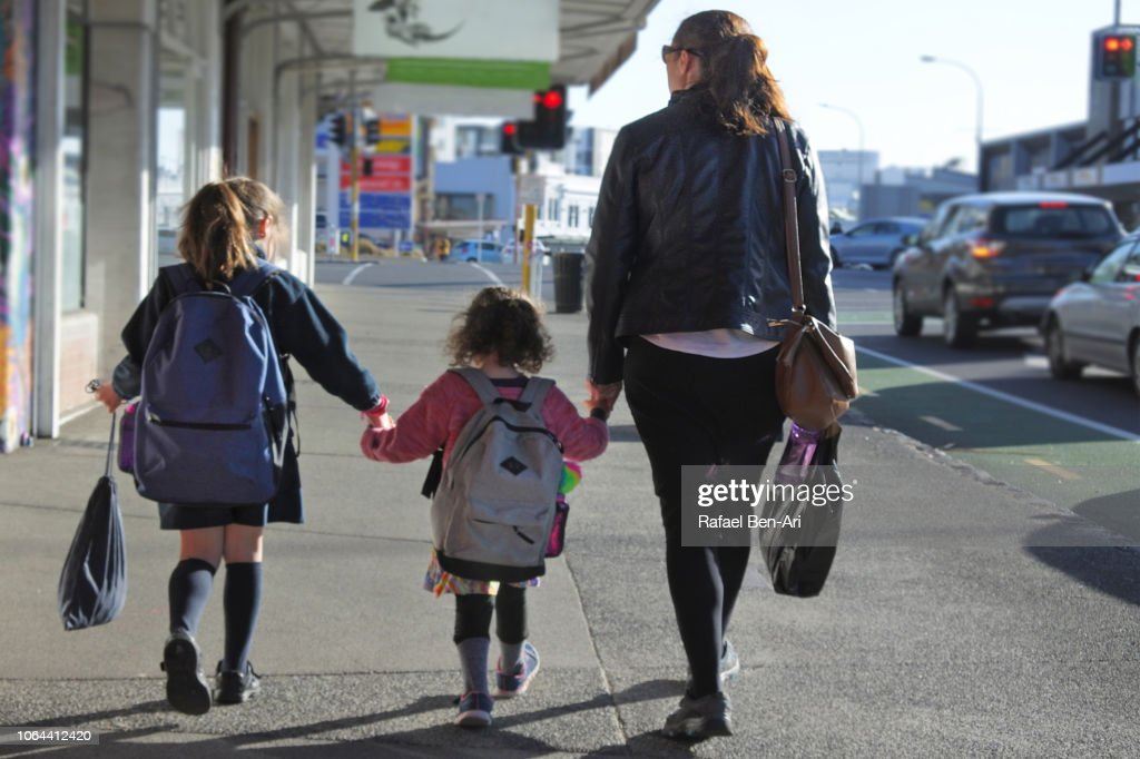 Mother Walking her Two Daughters to/from School : Stock Photo
