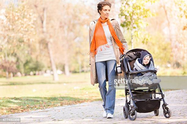 Mother walking in the park with her baby