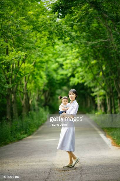 Mother walking with baby girl