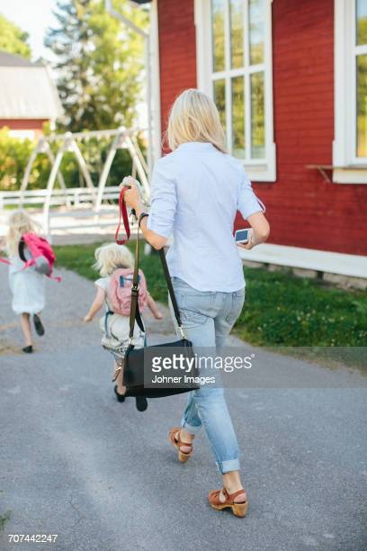 Mother walking with daughters