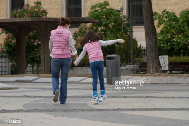 Mother walking with her daughter on April 26​ at Plaza de Coón in Madrid Spain Children in Spain which has had one of the stricter lockdowns in...