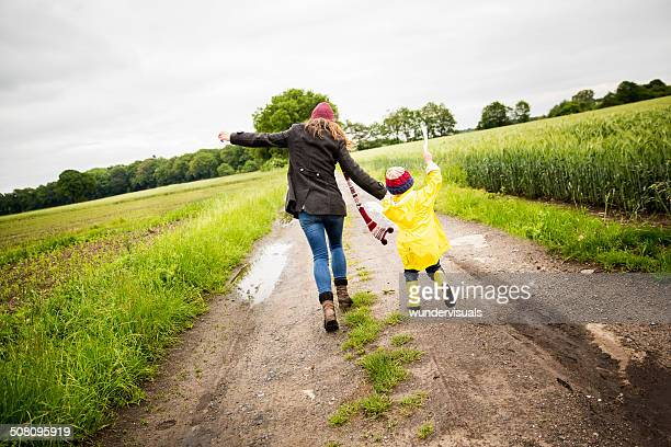 Mother Walks with Little Boy