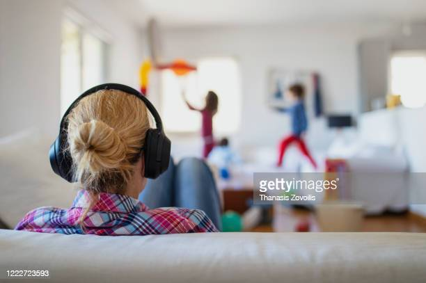 mother wearing headphones - parenting stock pictures, royalty-free photos & images