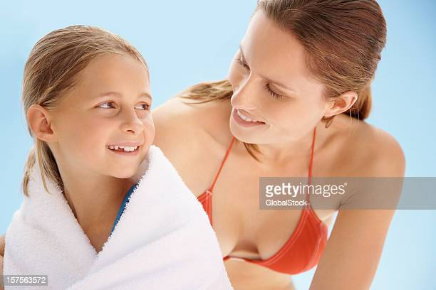 mother wiping her daughter with towel after a swim - little girl cleavage stock photos and pictures