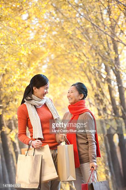 Mother with adult daughter shopping in Autumn