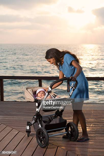Mother with baby at sunset time.