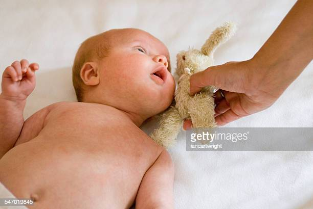 Mother with baby  boy and cuddly toy
