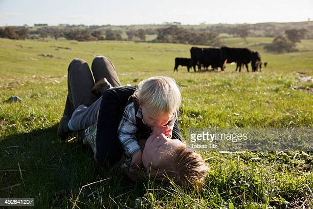 Mother with baby boy lying on grass