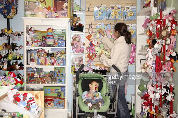 mother with baby daughter in baby store