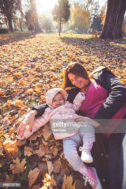 Mother with baby girl having fun in park