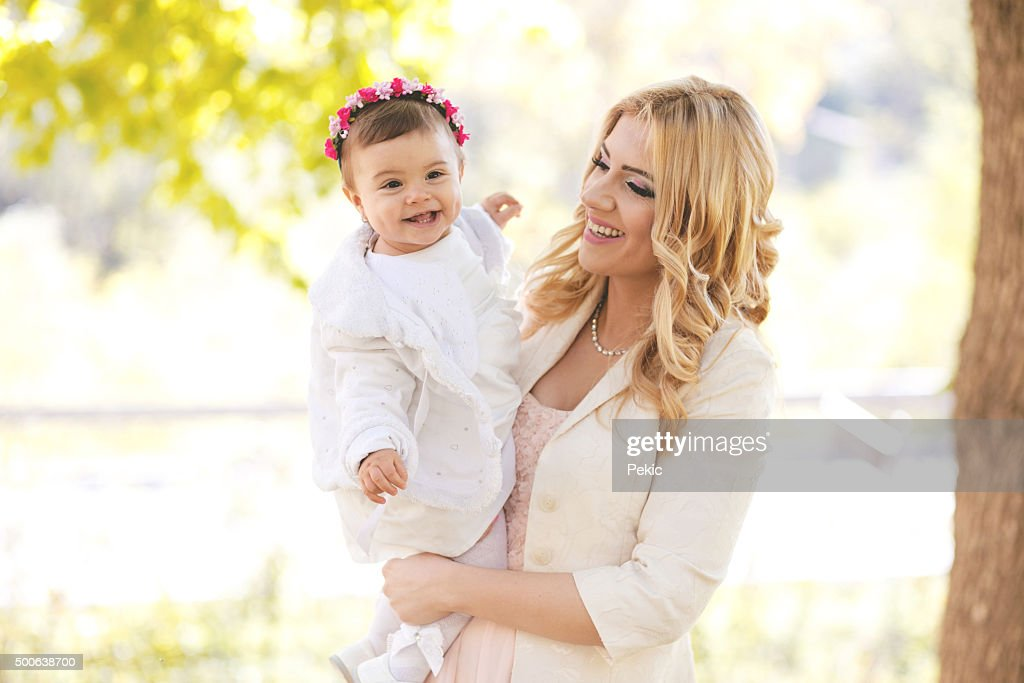 Mother with baby girl having fun in park : Stock Photo