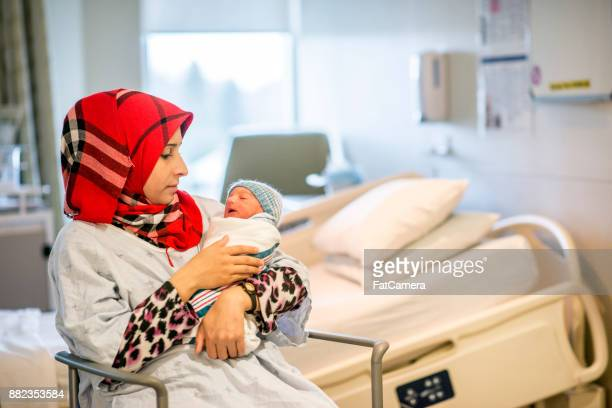 mother with baby in hospital room - birthing chair stock pictures, royalty-free photos & images