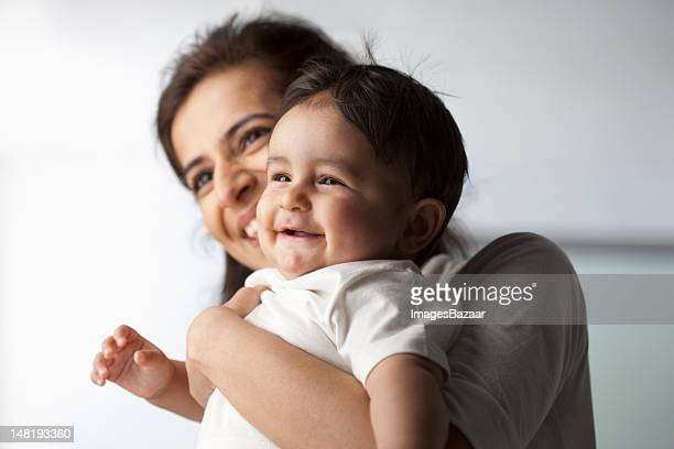 mother with baby son (12-17 months) - indian subcontinent ethnicity stock pictures, royalty-free photos & images