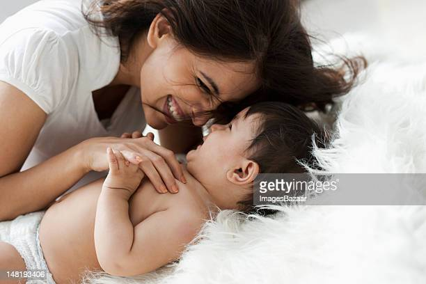 mother with baby son (12-17 months) - indian baby stock photos and pictures