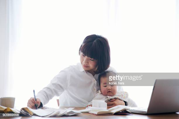 Mother with baby working at home